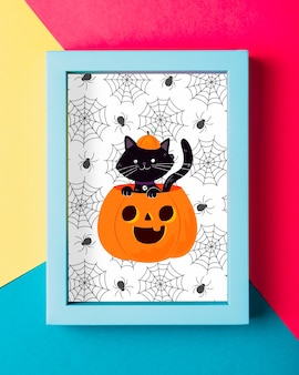 Halloween frame concept with black cat and pumpkin