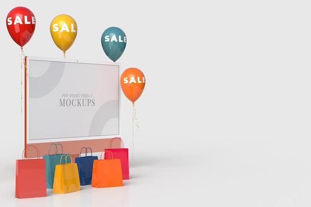 24-дюймовый монитор-макет хэллоуина с сумкой для покупок и распродажей воздушных шаров. дизайн концепции маркетинга в интернете