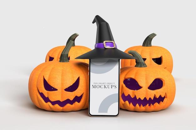 Halloween mock-up  pumpkins, witch hat  with smartphone. halloween concept mockup