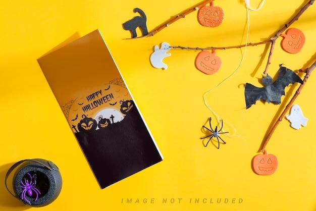 Halloween mockup brochure with holiday decoration. Premium Psd