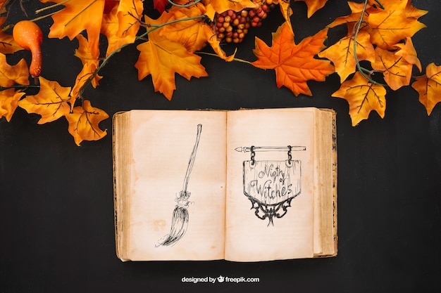 Halloween mockup with autumn leaves and book