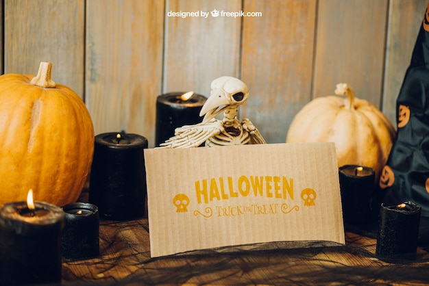 Halloween mockup with bird skeleton and card