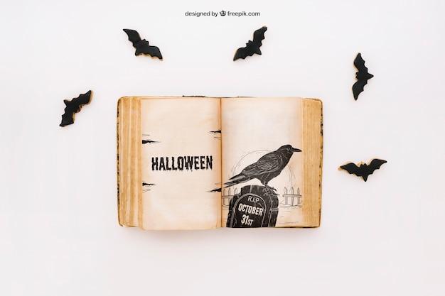 Макет хэллоуина с книгой и летучими мышами