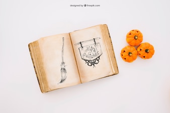 Halloween mockup with book and pumpkins