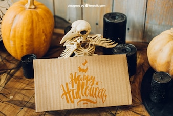 Halloween mockup with cardboard and bird skeleton