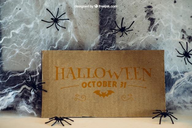 Halloween mockup with cardboard and cobweb