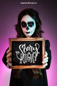 Halloween mockup with girl holding slate