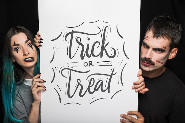 Halloween mockup with lettering on big board and couple