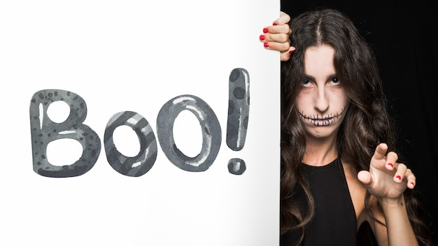 Halloween mockup with lettering on big board and woman