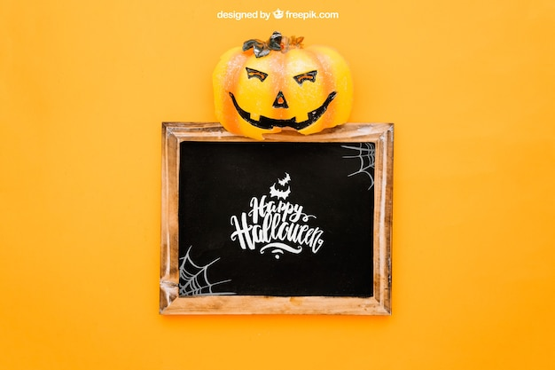 Halloween mockup with pumpkin op top of slate