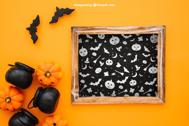 Halloween mockup with slate and pumpkins