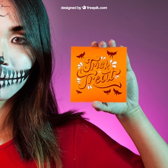 Halloween mockup with with girl holding card in hand