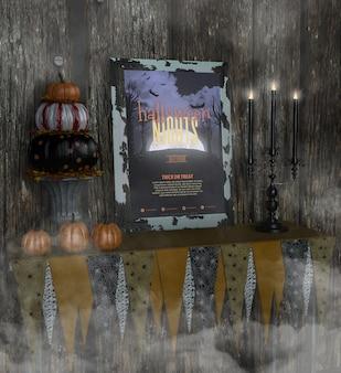 Le notti di halloween incorniciano il modello e il mucchio di zucche