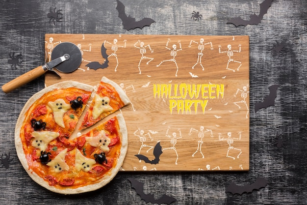 Halloween party with decorative pizza