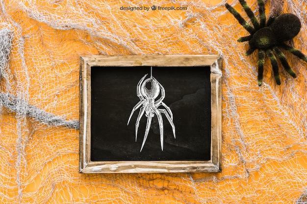 Halloween slate mockup on cobweb