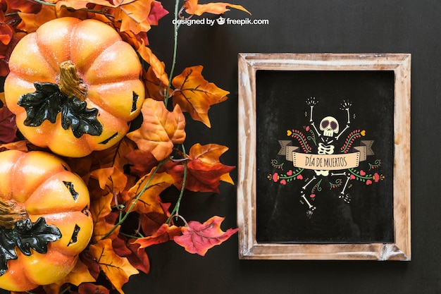 Halloween slate mockup with pumpkins and autumn leaves
