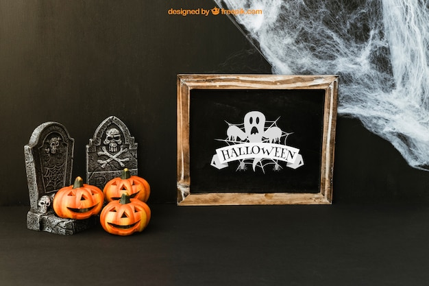 Halloween slate mockup with pumpkins on tombstones
