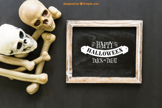 Halloween slate mockup with two skulls and bones