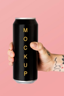 Hand holding a black aluminum can psd mockup