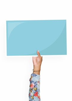 Hand holding a blank cardboard prop