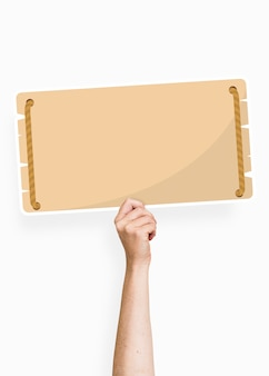 Hand holding a blank signage cardboard prop