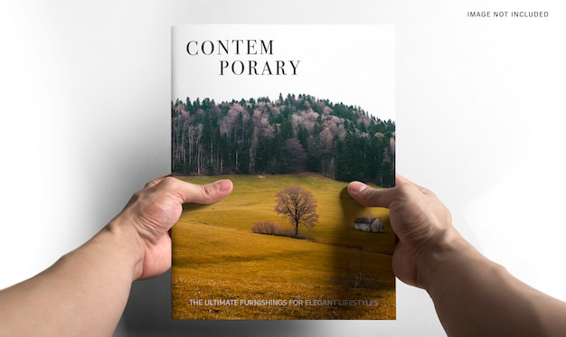 Hand holding a book mockup