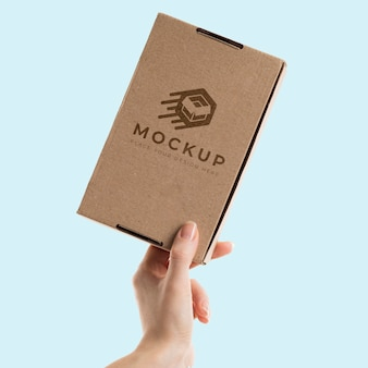 Hand holding a box mock-up