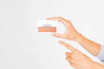 Hand holding business card mockup