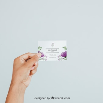 Hand holding business card's mock up