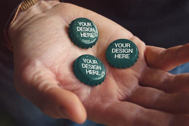 Hand holding caps