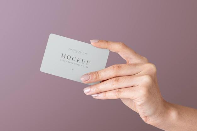 Hand holding a card psd mockup