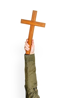 Hand holding cross