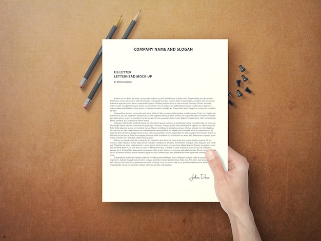 Hand holding document mock up