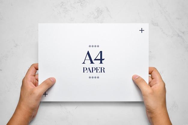Hand holding flyer mockup