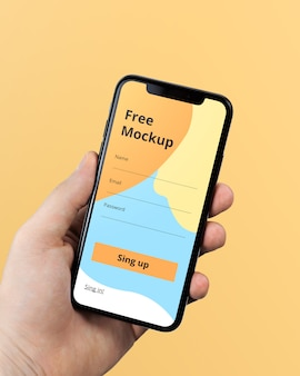 Hand holding iphone x mockup