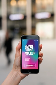 Hand holding modern smartphone