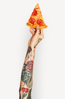 Hand holding pizza