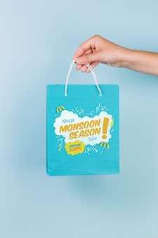 Hand holding shopping bag mockup