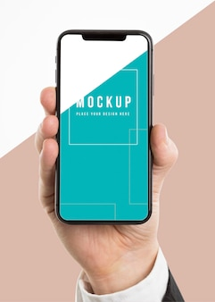 Hand holding a smartphone mock-up