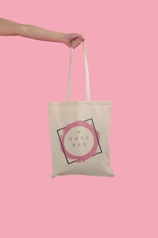 Hand holding tote bag
