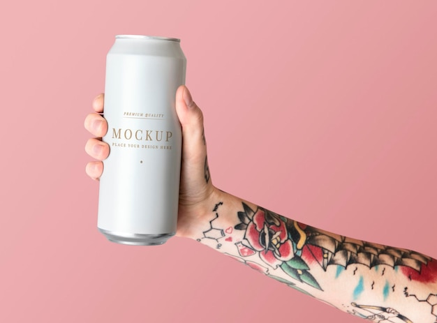 Hand holding a white aluminum can psd mockup