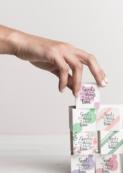 Hand touching colorful blocks with quotes