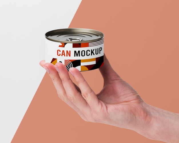 Hand with tin can
