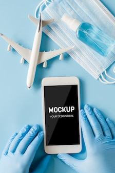 Hands in disposable gloves hold smartphone