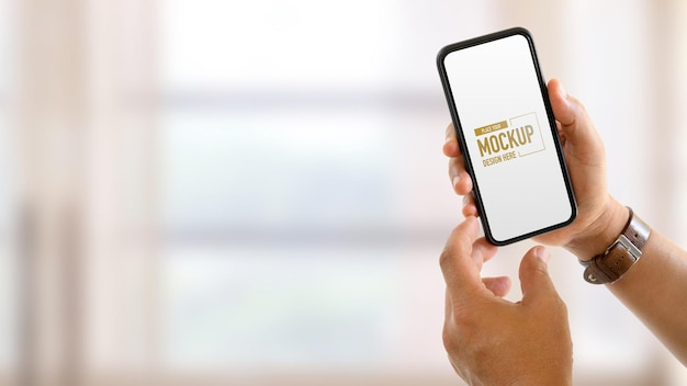 Hands having and touching mockup smartphone