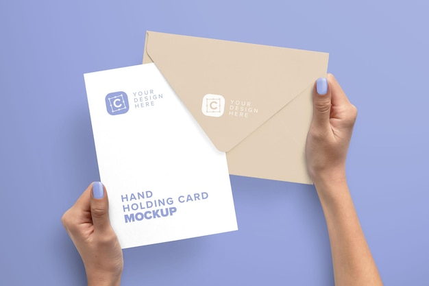 Hands holding 5x and envelope