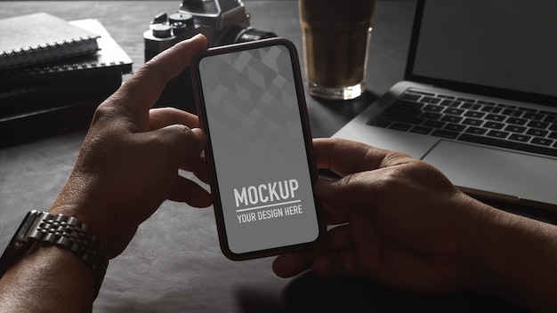 Hands holding smartphone screen mockup