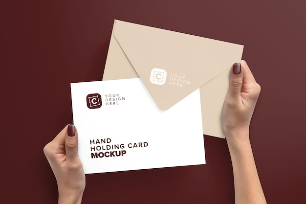 Hands holding x5 and envelope