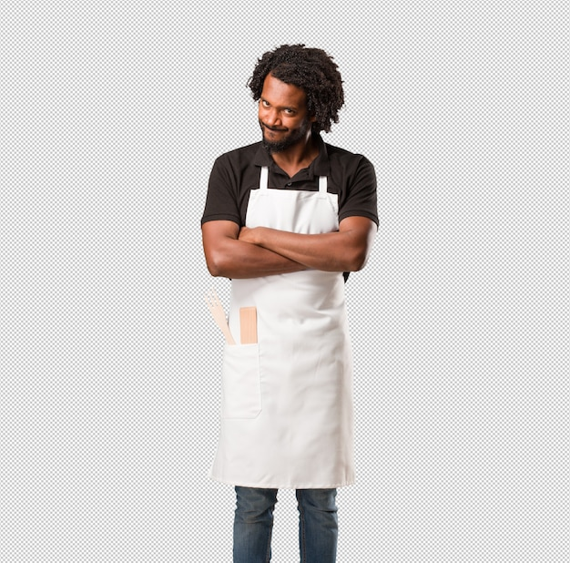 Handsome african american baker very angry and upset, very tense, screaming furious, negative and crazy
