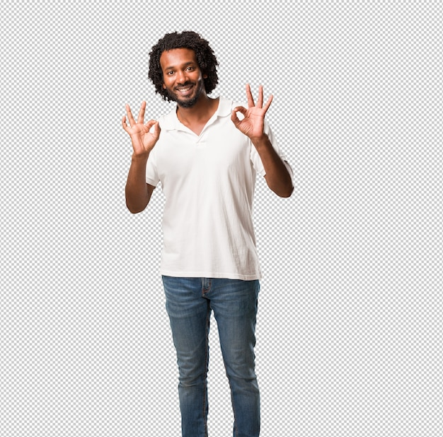 Handsome african american cheerful and confident doing ok gesture, excited and screaming, concept of approval and success